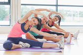 Fitness class and instructor doing stretching pilate exercises — Stock Photo