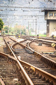 Railroad metal track with track bed — Stok fotoğraf