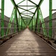 Footbridge with symmetrical metal structure — Stock Photo #36250063