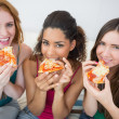 Portrait of happy female friends eating pizza at home — Stock Photo
