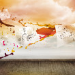 Sheets with graphics over sky on wall — Stock Photo