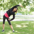Full length of a healthy woman doing stretching exercise in park — Stock Photo #36250323