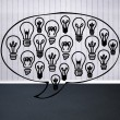 Light bulbs graphic in empty grey room — Stock Photo