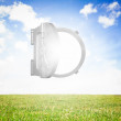 Open safe on sunny landscape background — Stock Photo