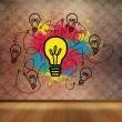 Stock Photo: Colourful light bulbs graphic in empty brown room