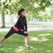 Healthy woman doing stretching exercise in park — Stock Photo #36251077