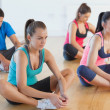 Stock Photo: Fitness class and instructor doing butterfly stretch