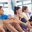Side view of a group of fitness class sitting in row — Stock Photo #36251483