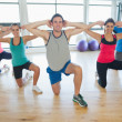 Fitness class and instructor doing pilates exercise — Stock Photo