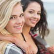 Close up of two women covered with blanket at beach — Stock Photo #36251747