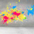 Splashes of color on grey wall — Stock Photo