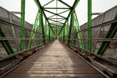 Footbridge with symmetrical metal structure — Stock Photo