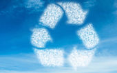 White recycling circle in sky — Stock Photo