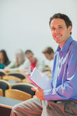 Teacher with young college students in the classroom — Stock Photo