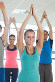 Fitness class with hands joined at exercise studio — Stock Photo
