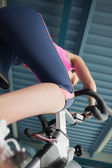 Determined young woman working out at spinning class — Stock Photo