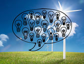 Light bulbs graphic on bright countryside with wind turbines — Stock Photo