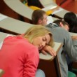 Stock Video: Student asleep at desk in lecture hall
