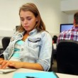 Concentrating student learning in computer class — Stock video