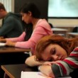 Stock Video: Student asleep at her desk in class