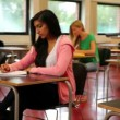 Stock Video: Quiet students sitting in classroom and taking notes