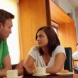 Stock Video: Couple chatting together in canteen