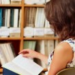 Young woman studying in library — Stok video