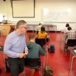 Stock Video: Lecturer walking around his class during exam