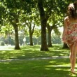Stock Video: Attractive brunette bouncing through park