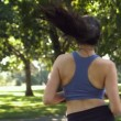 Brunette running in park — Stock Video #36278849