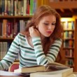 Focused student studying in the library — Stock Video