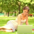 Stock Video: Happy student using laptop outside