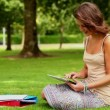 Pretty student using tablet pc outside — Stock Video #36279537