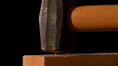 Hammer banging a nail into wood — Stock Video