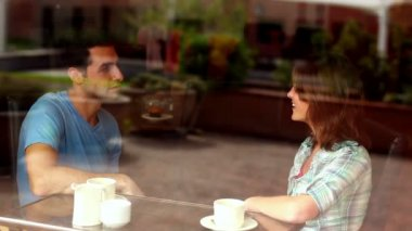 Couple chatting together in the canteen having coffee — Stock Video