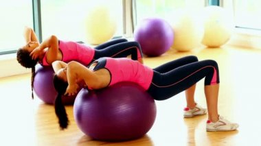 Attractive slender women doing sports exercise using fitness balls — 图库视频影像