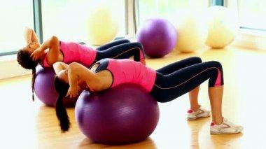 Attractive slender women doing sports exercise using fitness balls — ストックビデオ