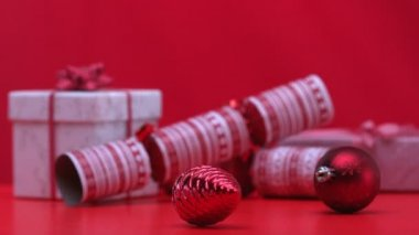 Christmas decorations spinning beside crackers and presents — Stock Video