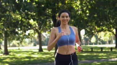 Happy brunette running in park — Stock Video