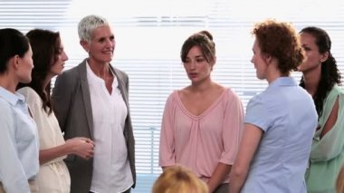 Businesswomen standing and talking after a seminar — Stock Video
