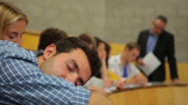 Student napping in the lecture hall and then waking up — Stock Video
