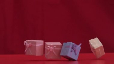 Presents falling and dropping on red background — Stock Video
