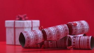 Christmas crackers falling and bouncing beside present — Stock Video