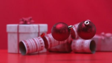 Christmas baubles dropping and bouncing beside crackers and presents — Stok video