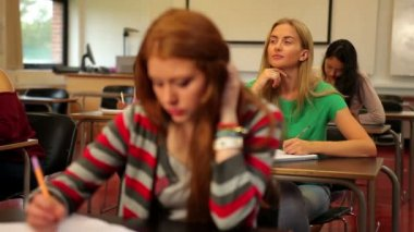 Blonde student thinking in class — Vídeo de Stock
