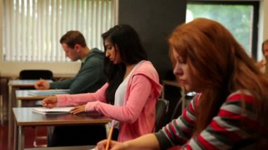 Attentive students sitting in a classroom and taking notes — Stock Video