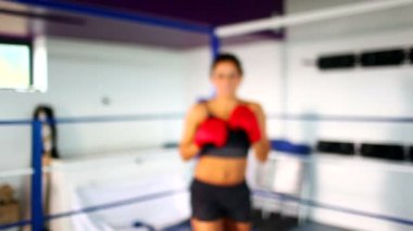 Aggressive fit woman wearing red boxing gloves boxing — 图库视频影像