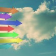 Colorful arrows pointing against sky — Stock Photo #38454017