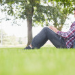 Happy student using his laptop to study outside — Stock Photo #38455257