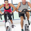 Young mand womworking out at spinning class — Stock Photo #38455341